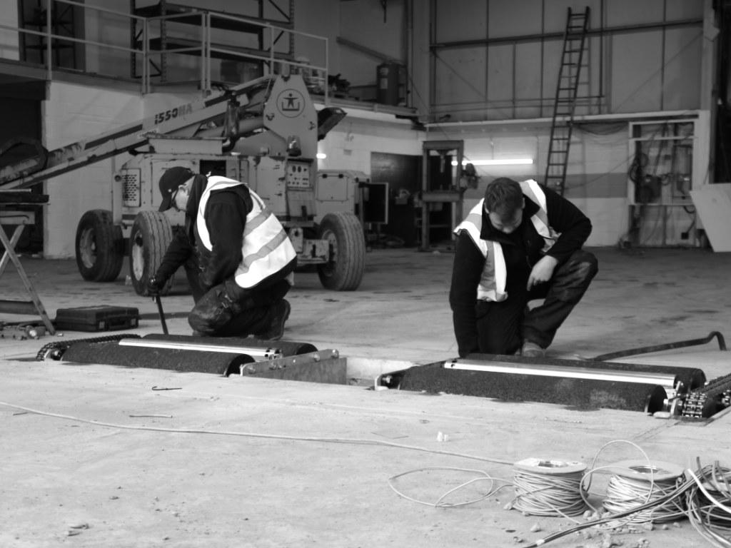 Engineers installing a brake tester